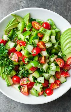 This healthy Tomato Cucumber Salad recipe is ready in minutes! This quick and easy salad is light, fresh, and full of flavor! Cucumber Avocado Salad, Avocado Salad Recipes, Salad Recipes Video, Salad Recipes For Dinner, Healthy Recipe Videos, Healthy Salad Recipes, Healthy Foods To Eat, Healthy Snacks, Vegetarian Recipes
