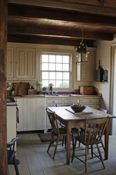 Not sure what I like about this... the table the kitchen the whole feeling of a welcoming kitchen.  Love it!