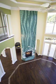 Custom fireplace mosaic by Granite Transformations #fireplace #holiday #mosaic