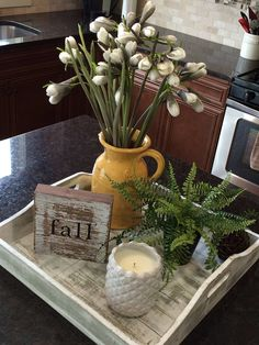 Love this decor idea for a kitchen island or peninsula! Tray makes it easy to move out of the way when using counterspace.