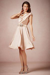 Satin rose colored dress.