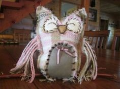 Stuffed scarf owl. made from discarded scarf and a bit of felt and stuffing.