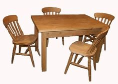 Lovely pine farmhouse table with shaker style  legs and slat back chairs.
