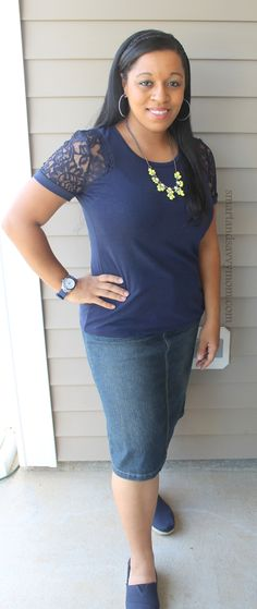 navy blue top with lace sleeves, yellow necklace, and denim pencil skirt - modest outfit idea