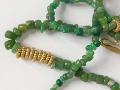 Hey, I found this really awesome Etsy listing at https://www.etsy.com/listing/244186701/delicate-beaded-necklace-ancient-green