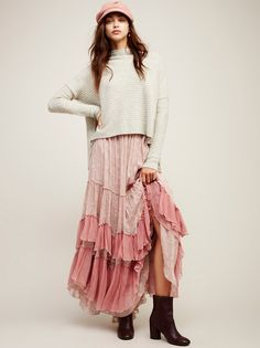 See You Tonight Maxi Skirt | Ultra femme maxi skirt with beautiful contrast ruffle details and a delicate floral print throughout. Exposed seams and slight distressing creates a lived-in look. Lightweight semi-sheer fabrication. Fully lined. Hidden side zipper closure.