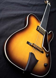 Model-T Jazz semi-hollowbody, with T-Brown Sunburst, two piece spruce top, two piece mahogany back and a Gibson Burstbucker.
