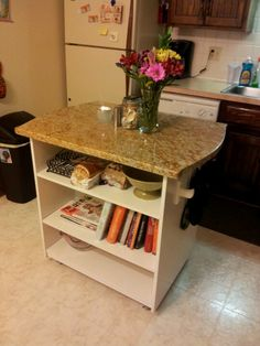 Granite top island we made with 2 bookshelves! We siliconed and screwed them together. Added wheels on the bottom and put a small piece of handcrafted granite on top. Price: $65 :)