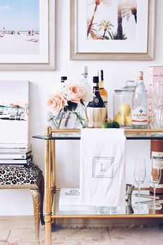 This bar cart is so chic! They monogrammed towel adds that perfect classy touch to the already luxurious cart
