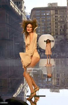 Model parades on an open air catwalk for the launch of the 2004 Spring Summer Myer Fashion at Martin Place August 9, 2004 in Sydney, Australia. (Photo by Patrick Riviere/Getty Images)es)