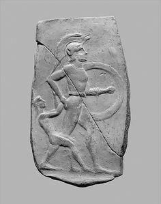 terracotta relief of a warrior dragging a small female captive. Period: Archaic  ca. 540–520 B.C.E. Culture: Greek, Cretan.