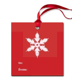 Pineider presents a set of six red, Pineider watermarked, gift tags with a snowflake printed in white from a hand-engraved die and white silk ribbon.
