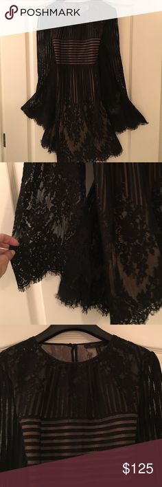 Gorgeous never worn black lace dress Oh.  My.  This dress is a stunner!  Still in some BCBG stores.  Bell sleeves, eyelash lace - high quality lace lined with nude soft lining.  Has a cocktail party vibe but also wear it with black tights or leggings. BCBGMaxAzria Dresses