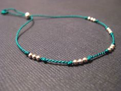 Tiny Sterling Silver Friendship Bracelet Silk Cord by SoulSilk, $15.00