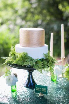 Elegant gold & white cake: http://www.stylemepretty.com/little-black-book-blog/2015/09/01/jewel-tone-forest-wedding-inspiration/ | Photography: Heather Cook Elliott - http://heathercookelliott.com/
