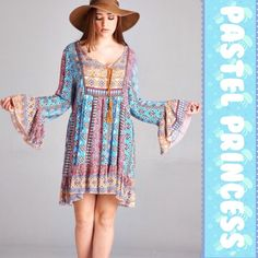 "💥HP 4/2💥MULTI COLORED PASTEL BOHO DRESS/TUNIC Beautiful strips of multiple pastel color patterns in this cute boho dress or tunic. Bell sleeves with front tassel tie-up. 100% rayon                           ♦️1X: Bust 46"" hips 67"" length 36""                         ♦️2X: Bust 48"" hips 69"" length 36""                       ♦️3X: Bust 50"" hips 71"" length 36.5"" tla2 Dresses Mini"