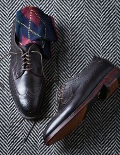 Classic pair of Allen Edmonds wingtips sported with a pair of Rugby socks.