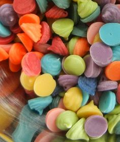 Sugar Swings - How to make your own colored chocolate chips.  Melt white candy wafers, add drops of color you want, pipe onto wax paper to harden.