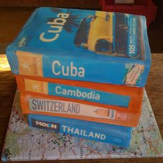 Grooms Gone Wild! Travel Guidebooks  The Bakers: Amazing Kakes, Austin, TX  The Challenge: Give the wedding some global inspiration.  Fun Fact: Each book represented a place the bride and groom visited.