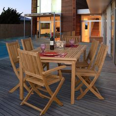 You'll enjoy entertaining friends and family with this outdoor dining set. The light brown, solid teak furniture is weather resistant for years of enjoyment. The set includes one rectangular table, four folding chairs, and two folding armchairs.