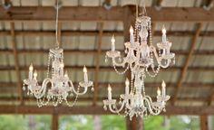 Hanging chandeliers at outdoor wedding