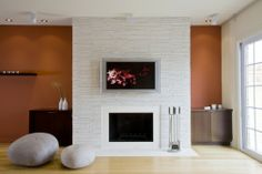 White Orange Living Room With White Stacked Stone Fireplace