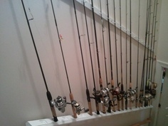 Organize fishing rods and reel.  We used the staircase going to our bonus room. Taking a decking rail use the bottom where u would normally put a slate and place the bottom wound of the rods in those. you first need to place the rail right  above the hand rail following the same path as the stair. The top holding the top part of the rods is a board with added hooks to hold the rod and reel  on it. We psintrf ours go match or trim work.