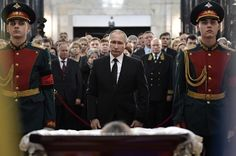 Russian President Vladimir Putin, center, attends a farewell ceremony for the Russian Ambassador to Turkey Andrei Karlov at the Foreign Ministry headquarters in Moscow, Russia, Thursday, December 22, 2016. Karlov was fatally shot by a Turkish policeman Monday in a gathering in Ankara, Turkey.
