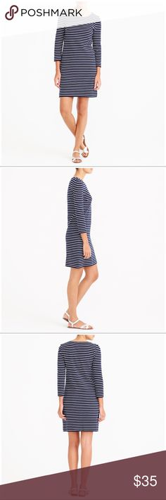 """RARE & SOLD OUT JCREW STRIPED MARITIME DRESS SZ XS This is a jcrew striped maritime dress in navy blue and white. The sleeves are 3/4, the length is mini (above the knee). The neck is a scoop style.   Original price: $65 Offers welcome!  Measurements:   Armpit to armpit: 18""""  Length: 31""""  #jcrew #striped #maritime #rugbystriped #navy #white #scoop J. Crew Dresses Mini"""
