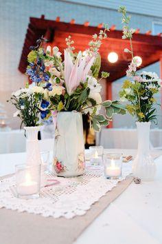 milk glass centerpieces.... Diff flowers
