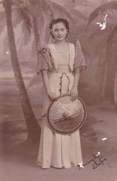 A photo my grandmother's friend gave to her...possibly from the 40s? I have a few photos like this: Filipina women wearing traditional dress and posing for a portrait. I just love this!