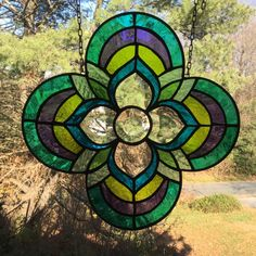 A personal favorite from my Etsy shop https://www.etsy.com/listing/258106960/quatrefoil-bevel-cluster-stained-glass
