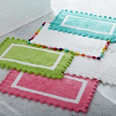 Pom pom bath mats from PB Teen - eep! soft little mats with pom poms. The turquoise to coordinate with the spotted one, or the white one with rainbow pom poms? Maybe both!