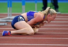 Sally Pearson shouts in pain after hitting an obstacle during the women's 100 hurdles event, at the Golden Gala IAAF athletic meeting, in Rome's Olympic stadium. She was carried off on a stretcher after getting attention to her left wrist area.