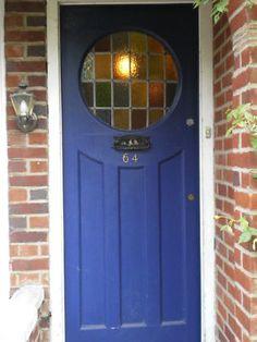 Front door blue with round window Porch Windows, House Front Door, House Front, Windows And Doors, House Styles, Entry Doors, Porch Doors, 1930s House, Doors