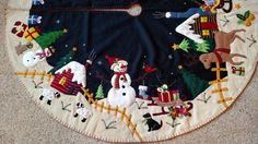 This gorgeous tree skirt has wonderful detail! It is pieced from wool flannel and felt, hand embroidered with tiny glass bead detail and blanket stitched around the outer edges. The front background is black with soft white snow. Christmas Tree Skirts Patterns, Types Of Christmas Trees, Christmas Villages, Christmas Decorations, Santa Sleigh, Santa And Reindeer, Christmas Snowman, Christmas Stockings, Balsam Hill Christmas Tree