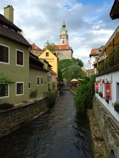 Water flows in a canal through Krumlov.