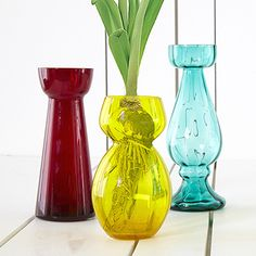 Set of 3 Floresta Bulb Vases: Start your favorite bloom in one of these colorful glass bulb vases!  Set includes one each of red, yellow and teal.  Sizes range from 3 1/4
