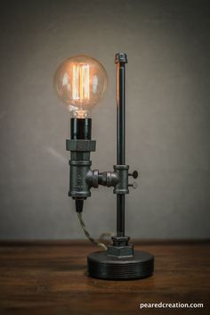 This industrial desk lamp is uniquely designed so that the height may be adjusted with a turn of a key. Each comes with the 40 watt vintage style edison bulb seen in the picture. The lamp also features a retro style cloth covered cord and inline switch. THE DETAILS: - Cord Length: