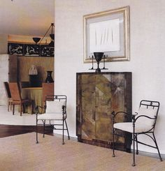 A painting by Lucio Fontana hangs above a Jean Dunand cabinet in the entry.