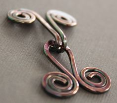 Handmade spiral copper cardigan clasp or sweater clasp for knit and fabric by IngoDesign on Etsy https://www.etsy.com/ca/listing/81293763/handmade-spiral-copper-cardigan-clasp-or