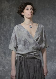 ecoprinted silk by YOD Photographer: Kalin Ruichev Model: Miroslava Zahova Hair and make-up: Mila Ateva Ceramic jewelry: Nadya Slavcheva Natural Dye Fabric, Fashion Vocabulary, Natural Clothing, Silk Tunic, Asymmetrical Tops, V Neck Blouse, Silk Top, Wearable Art, Textiles