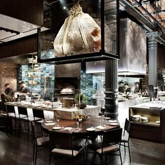 The restaurant has been designed by the Rockwell Group with the intention of bringing diners and chefs closer together, and to that end the concept of an open kitchen has been advanced to remove the walls separating the cooking area from the dining space entirely...