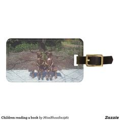 Children reading a book travel bag tags  This luggage tag features a beautiful photo of children reading a book. This picture was taken in a beautiful garden in the middle of spring. This fully customizable luggage tag features fill in the blank templates that allows easy customization. Makes a great gift. Purchase yours today!