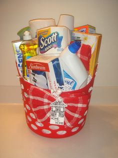 HouseWarming Gift Basket. I love the wash cloth as a bow. Doesn't link to a website, but you can get the idea from the photo.