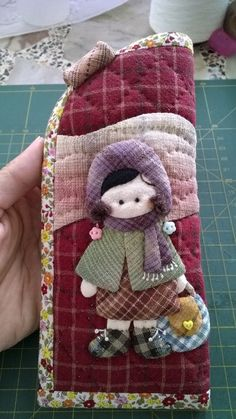 Eye glasses case. It make from real Japanese yarn dyed fabrics. So it is expensive. And I appliqué with my hand. I dont use glue. And quilt all.