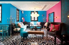 Pink, blue and geometric shapes collide for a beautifully eclectic room