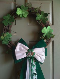 Love this St. Patrick's day wreath with St. Patrick on the bow! Tiffany always has the cutest liturgical wreaths!