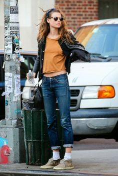Brown blouse with black cute jacket and dark blue casual stylish jeans and khaki warm boots and black leather hand bag
