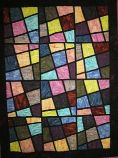 stained glass quilt  - I love this idea and will keep it for one of the future quilts.  I need to look for the pattern.